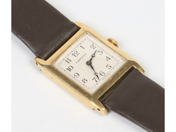A Cartier gold cased manual wristwatch.
