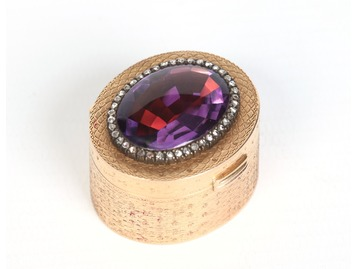 A gold, amethyst and diamond pill box.