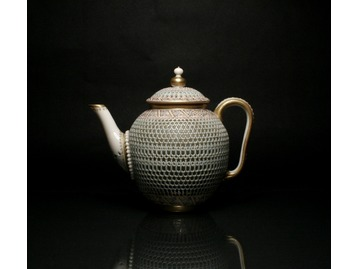 A Royal Worcester teapot by George Owen.
