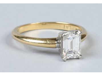 An 18 carat gold and platinum solitaire