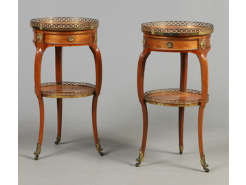 A pair of Regency walnut two tier single