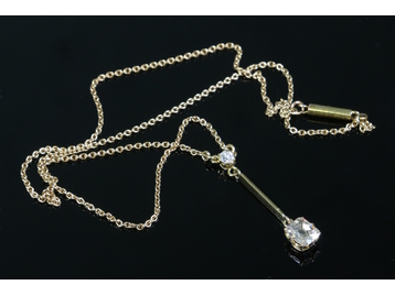 A 15ct gold drop pendant set with two di