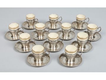 A set of twelve Lenox porcelain demitass