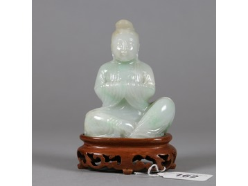 A Chinese pale jade figure.