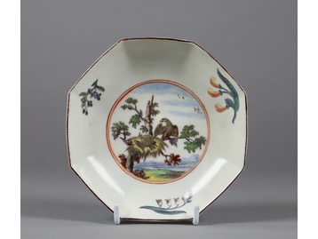 A Chelsea fable painted saucer.