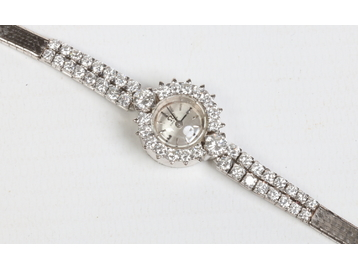 A ladies Art Deco Omega white metal and