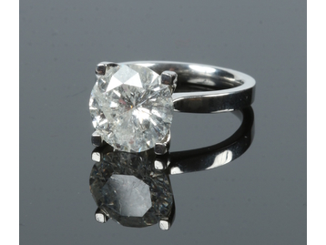 A platinum and diamond solitaire ring. W