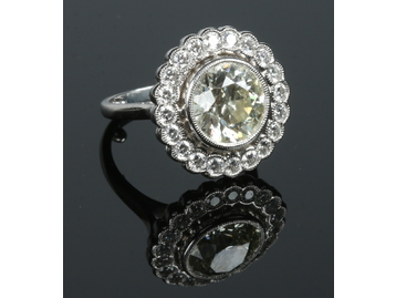 A platinum diamond set dress ring. The p