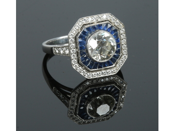 An Art Deco style platinum, diamond and