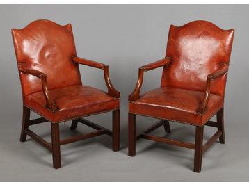 A pair of mahogany Gainsborough armchair