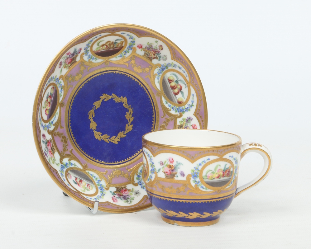 A Sevres coffee cup and saucer. With too
