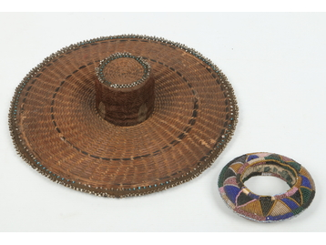 A Peruvian caneware hat with beadwork de