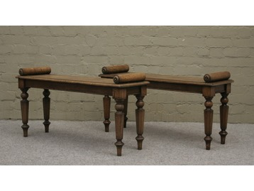 A pair of Regency hall benches.