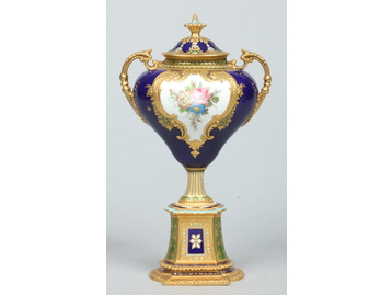 A very fine Royal Crown Derby twin handl