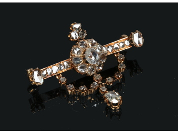 A yellow metal and diamond bar brooch su