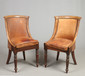 A pair of Regency mahogany leather uphol