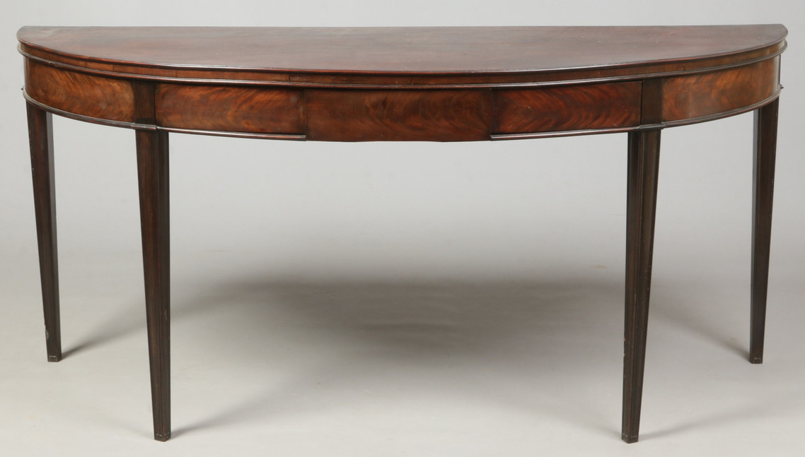 A 19th century bow front serving table.