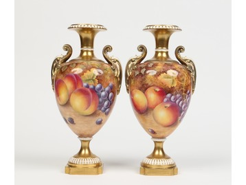 A pair of Royal Worcester urns.