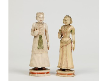 A pair of Indian ivory figures.