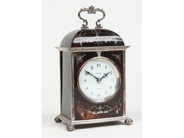 Silver and tortoiseshell clock.