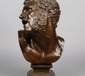 A 19th century patinated bronze bust of