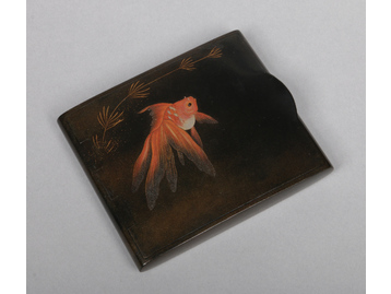 A Japanese Showa period lacquered papier